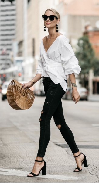 white wrap frill shirt with deep v-neck and black skinny jeans
