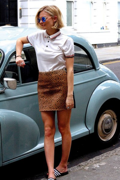 white polo shirt with high skirt with leopard print