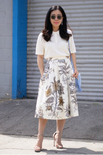 white top with red, floral printed midi skirt