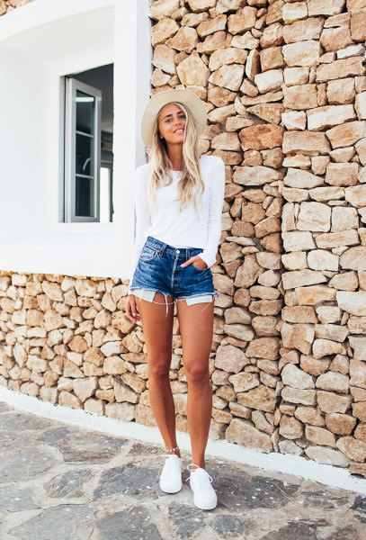 white sweater with blue denim shorts and light pink hat