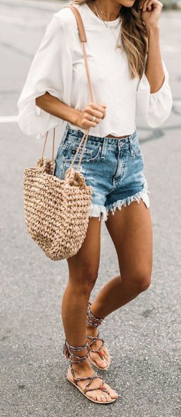 white wide blouse with half sleeves and blue distressed denim shorts