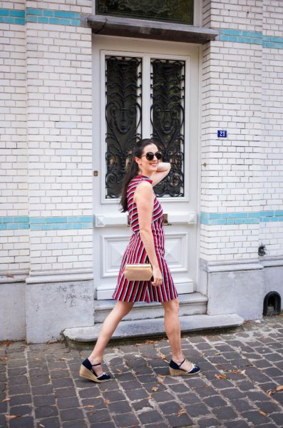 black and white striped sleeveless strap dress with wedge heel and rose gold purse