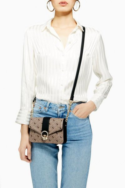 white striped silk shirt with buttons and light blue slim fit jeans