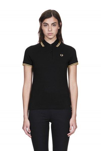 dark burgundy polo shirt with black skinny jeans