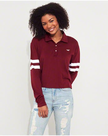 burgundy colored polo shirt with a relaxed fit and light blue boyfriend jeans