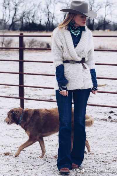 white sweater with belt, blue flared jeans and black square toe boots