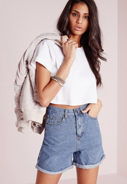 white short t-shirt with light pink bomber jacket and denim shorts