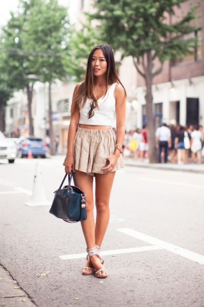 white short tank top with blushing, pink, flowing mini shorts
