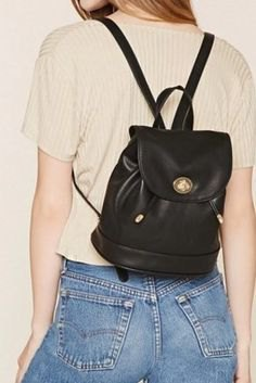 Light pink rib top with black leather, small backpack and jeans