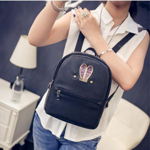 white sleeveless chiffon shirt with black small backpack wallet