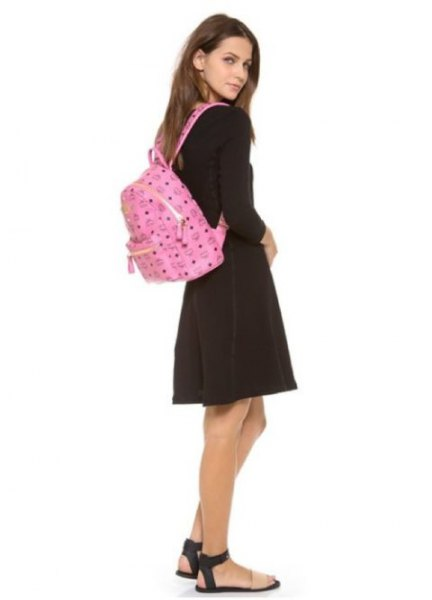 pink backpack wallet with black sweater and gray mini-skirt