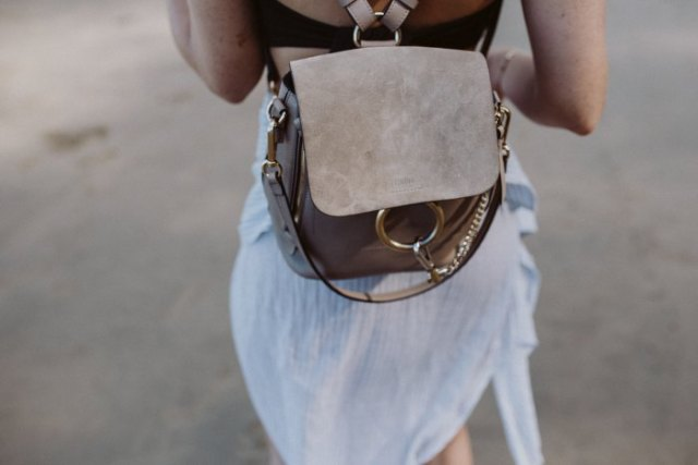 airy mini dress made of white chiffon with gray suede backpack handbag