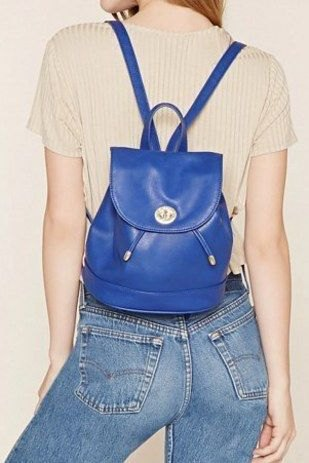 royal blue leather backpack with light pink short sleeve top