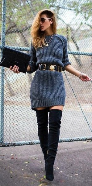gray sweater dress with belt and over the knee boots made of black suede