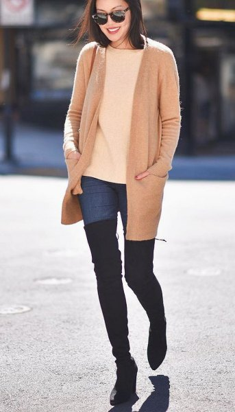 Blush pink wool coat with ivory sweater and over the knee boots