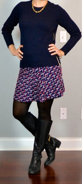 black sweater with scoop neck, printed mini skirt and knee-high zip boots