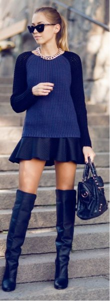 Dark blue, tailored sweater with black mini pleated skirt and over the knee boots