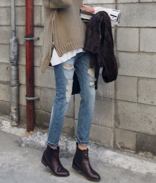 gray side slit sweater with torn jeans and black leather boots with zipper