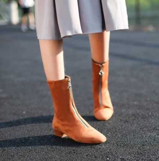green pleated midi dress with suede ankle boots with camel zipper