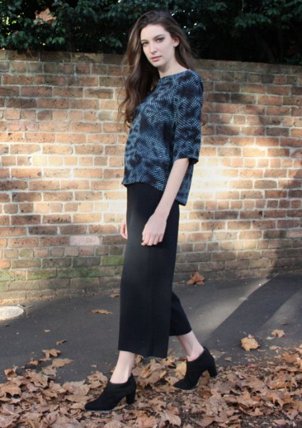 black velvet top with maxi skirt and high-heeled ankle boots
