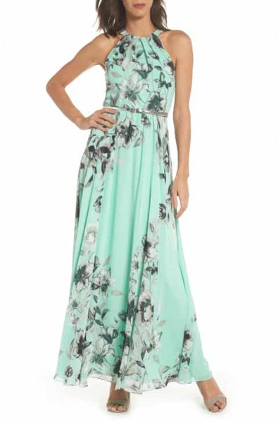 Light green maxi dress with floral print and belt with open toes