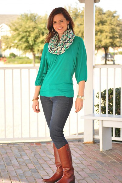 green long-sleeved chiffon top with infinity scarf and brown boots