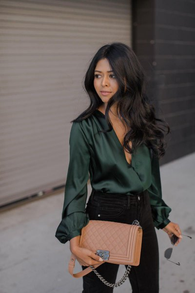 Emerald green silk long sleeve top with black skinny jeans