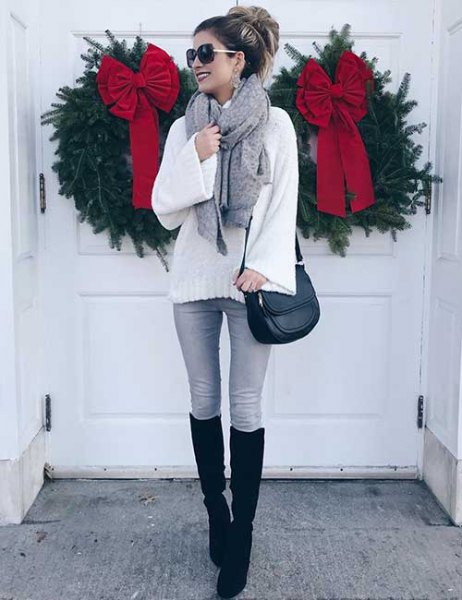 white, knitted sweater with gray skinny jeans and black, knee-high, high boots