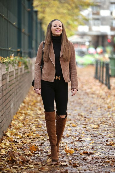 brown matt leather jacket with black jeans and high camel boots