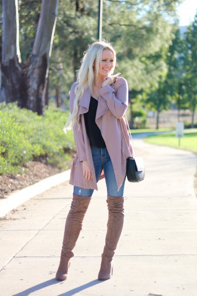 pink trench coat with blue skinny jeans and over the knee boots
