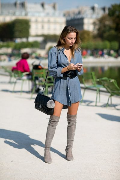 blue long-sleeved chambray shirt dress with over the knee boots