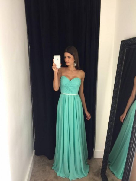 Fit and flap belt strapless floor-length pleated ball gown