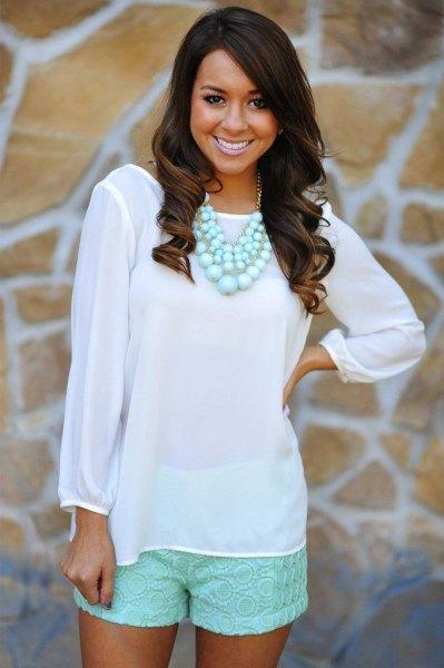 Mint green chiffon long sleeve blouse with light pink mini shorts