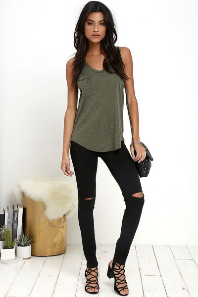 Olive green tank top with torn black skinny jeans