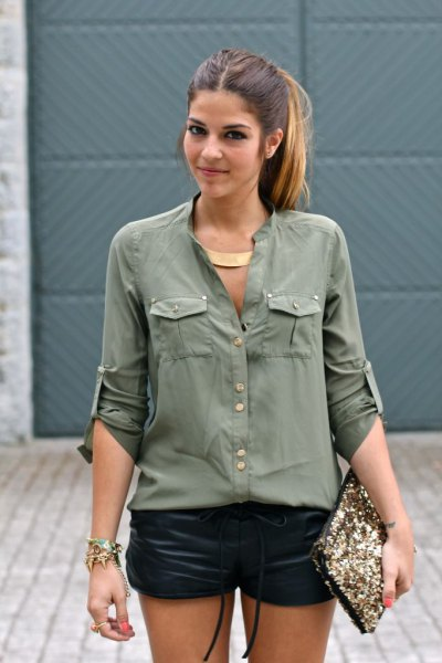 green utility shirt with buttons and black mini leather shorts