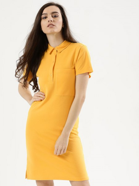 yellow polo shirt dress with white sneakers