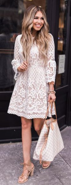 Long-sleeved swing dress made of white lace with pink strappy heels