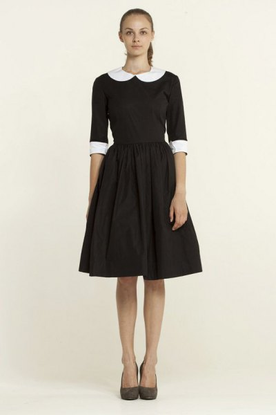 black, half-sleeved, flared mini dress with a round collar