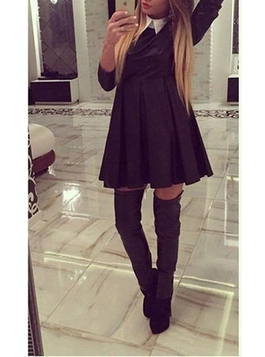 black pleated swing dress with gray over the knee boots
