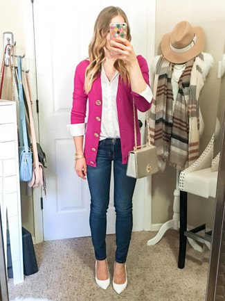pink slim fit cardigan with dark blue jeans