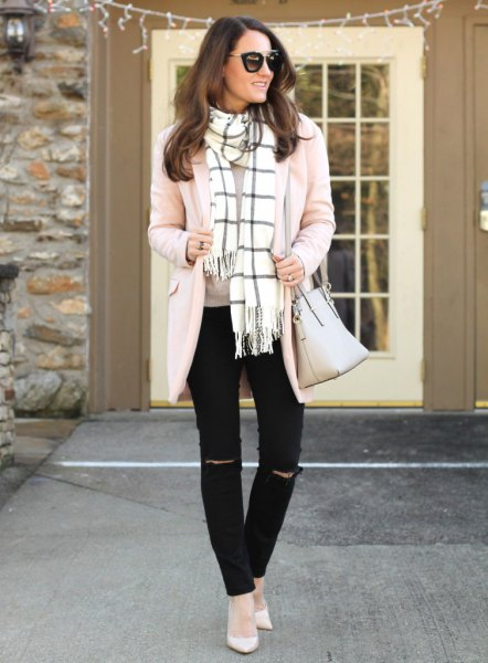 Light pink cardigan with white and black checkered fringed scarf