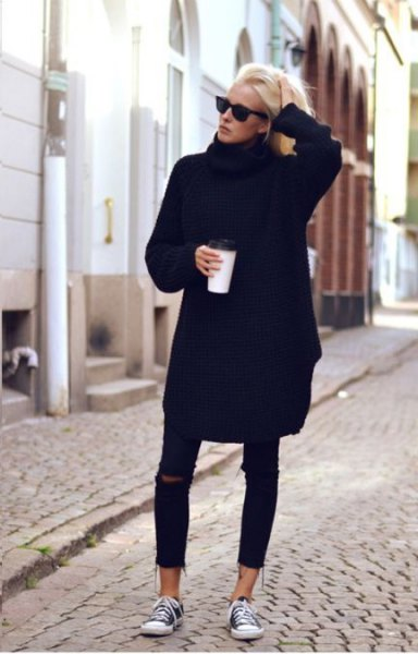 black sweater dress with torn skinny jeans