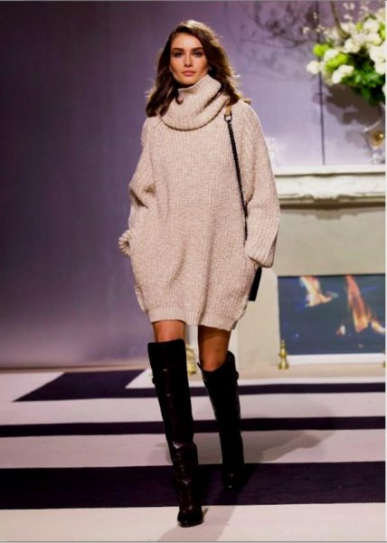 white turtleneck sweater dress with black, thigh-high leather boots