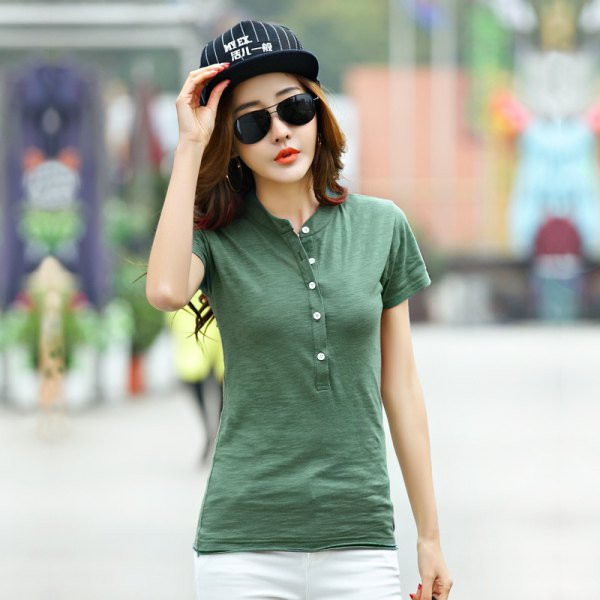green collarless polo shirt with white jeans and baseball cap