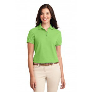 light green polo shirt with ivory skinny jeans