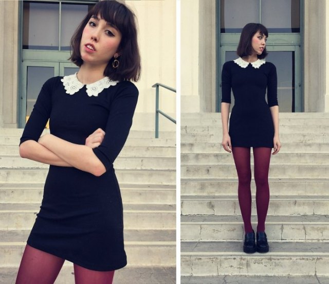 black dress with a scalloped collar and stockings and oxford shoes