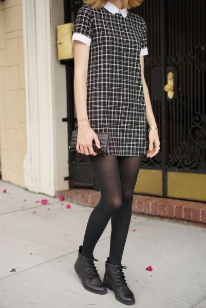 black and white checkered collar dress with stockings and leather boots
