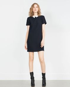 black mini shift dress with leather boots with medium calf leather
