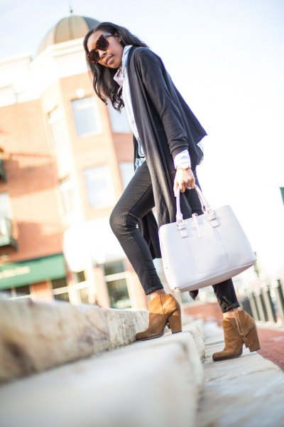 gray scarf sweater with light blue collar shirt and black coated skinny jeans
