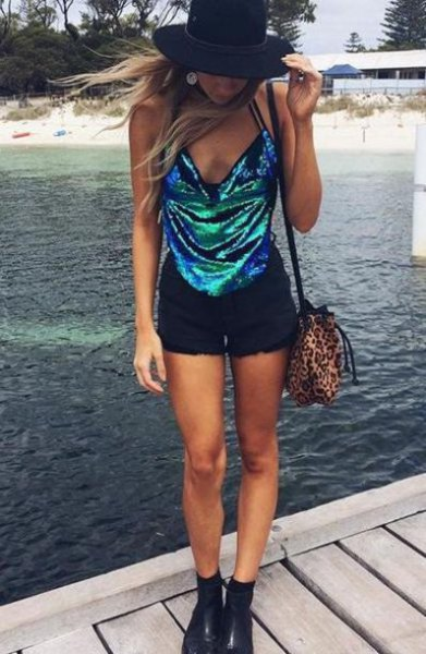 silver sequin halter top with deep v-neck and black mini shorts